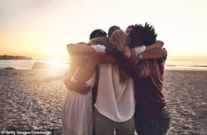 a group of people hugging, cuz people are important